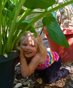 Adelyn playing in the garden